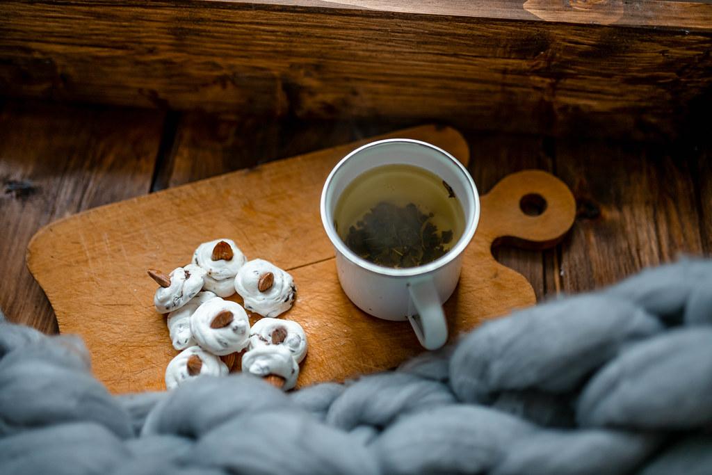 Warm Green Tea With Meringues Beze Cookies On Rustic Set.jpg