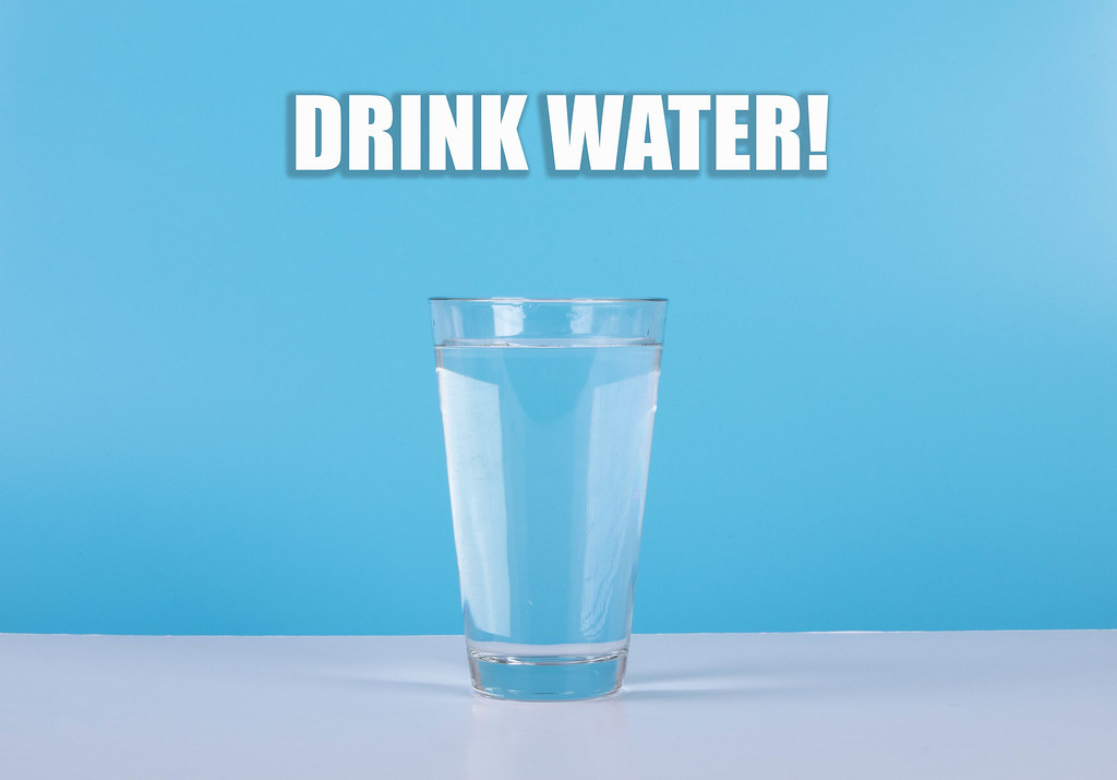 Water glass with Drink Water text