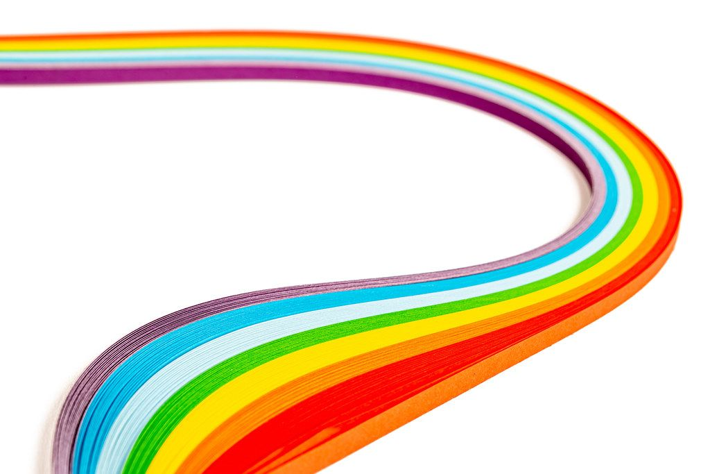 Wavy rainbow made from colored paper on white