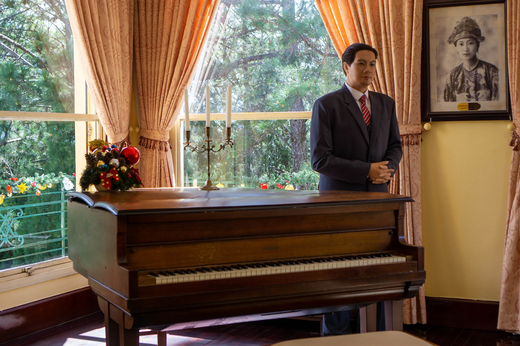 Wax Sculpture of Emperor Bao Dai of Nguyen Dynasty next to a Piano inside the King's Palace in Da Lat, Vietnam