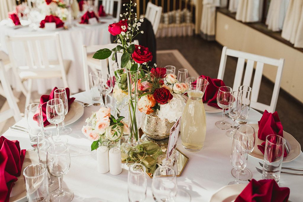 Wedding Decor Table Serving With Red Roses And Red Napkins