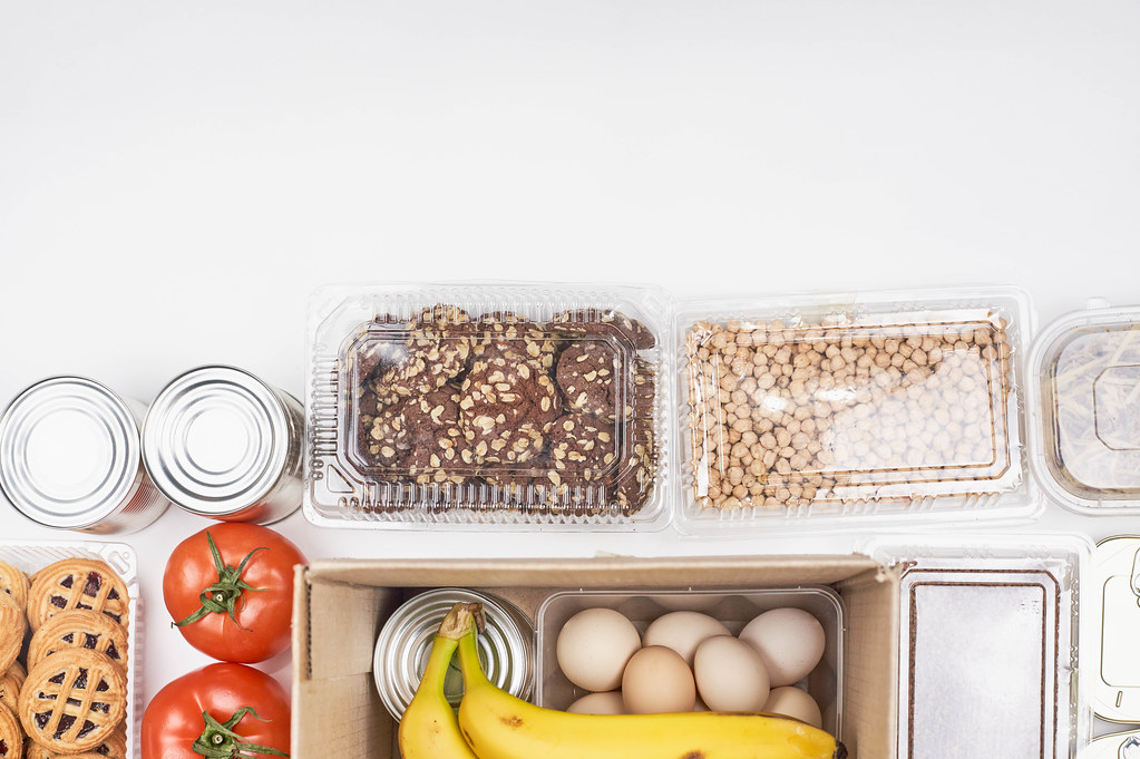 White background with food supplies and space for text at the top. Donations to prevent hunger
