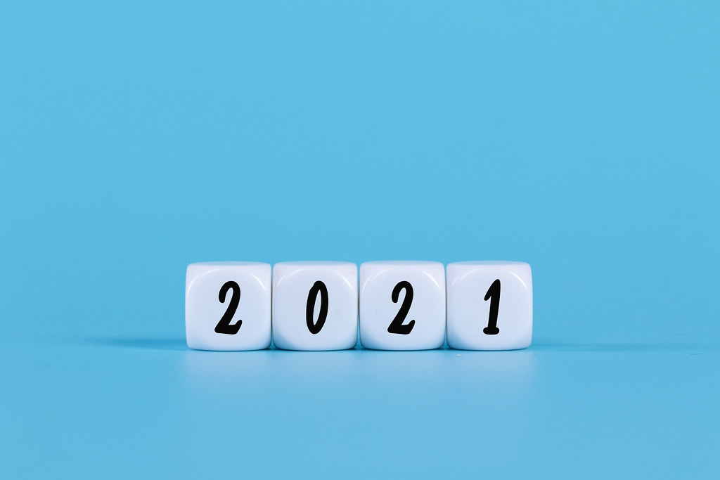 White cubes with 2021 text on blue background