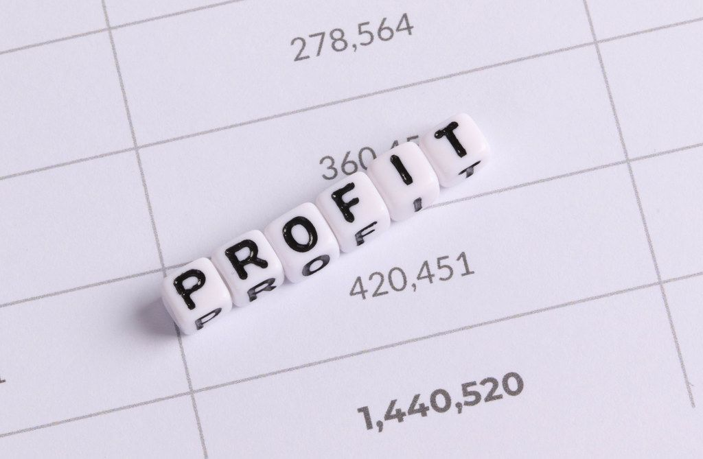 White cubes with Profit letters on financial document