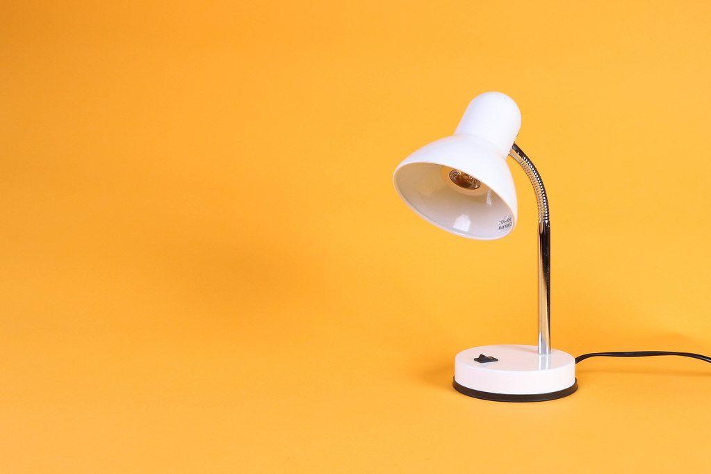 White desk lamp on orange background