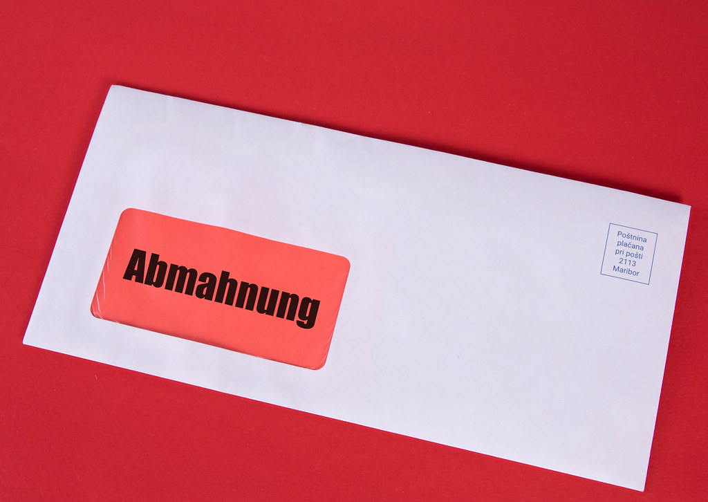 White envelope with Abmahnung text on red background