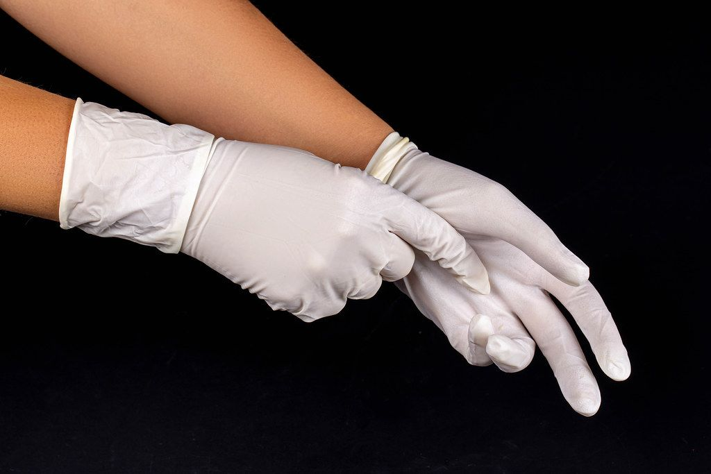 White latex medical gloves on a woman