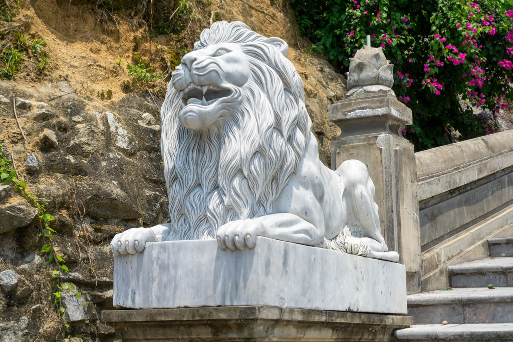 White Marble Lion Statue with Large Mane on the Beginning of the Stiarway to Linh Ung Pagoda on Son Tra Peninsula in Da Nang, Vietnam