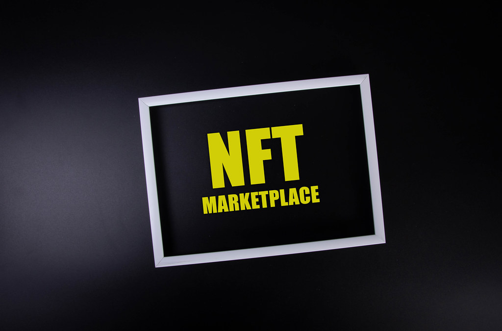 White picture frame with NFT Marketplace text on black