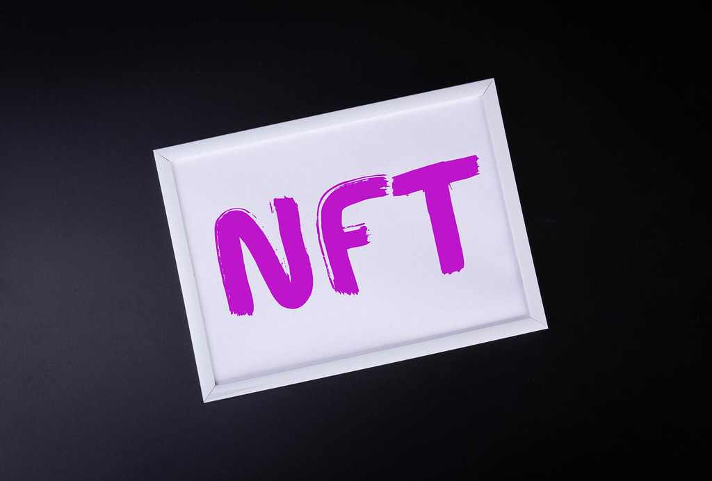 White picture frame with NFT text