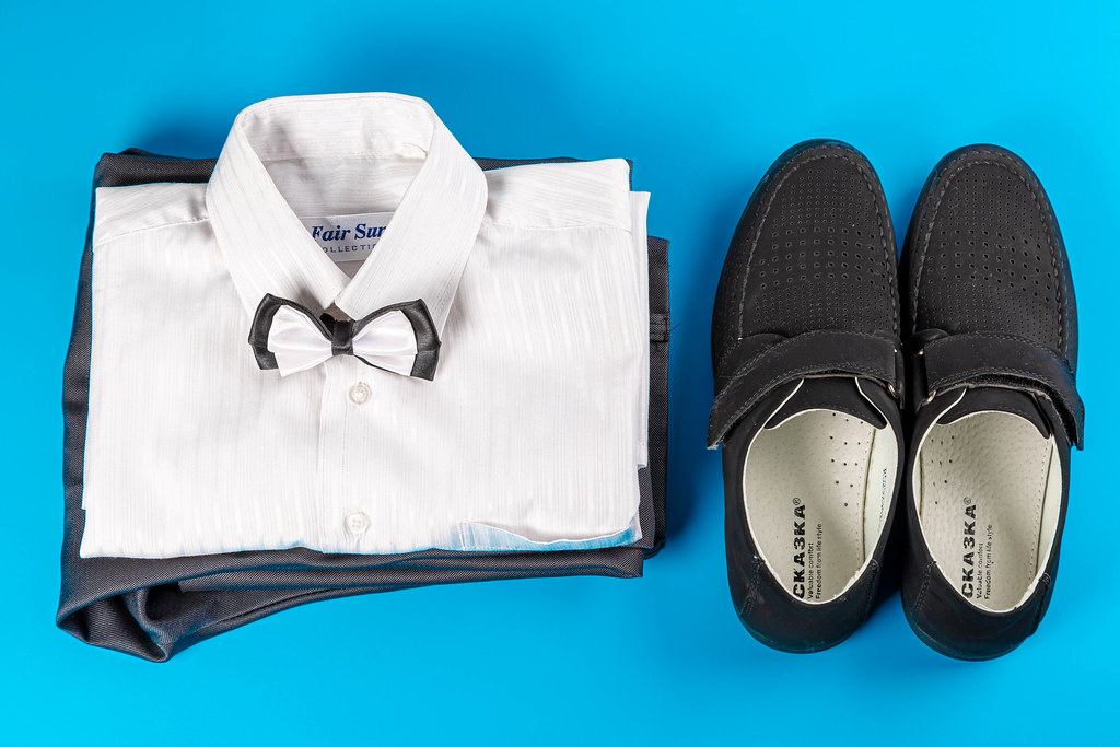 White shirt, trousers and black shoes on a blue background, children