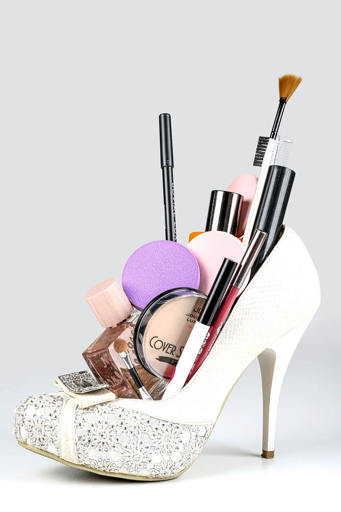White women's shoe filled with cosmetics