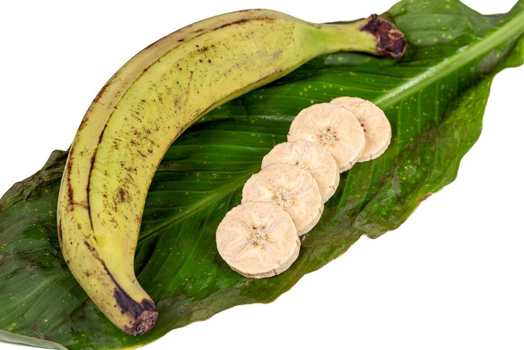 Whole and pieces of plantain on a green leaf