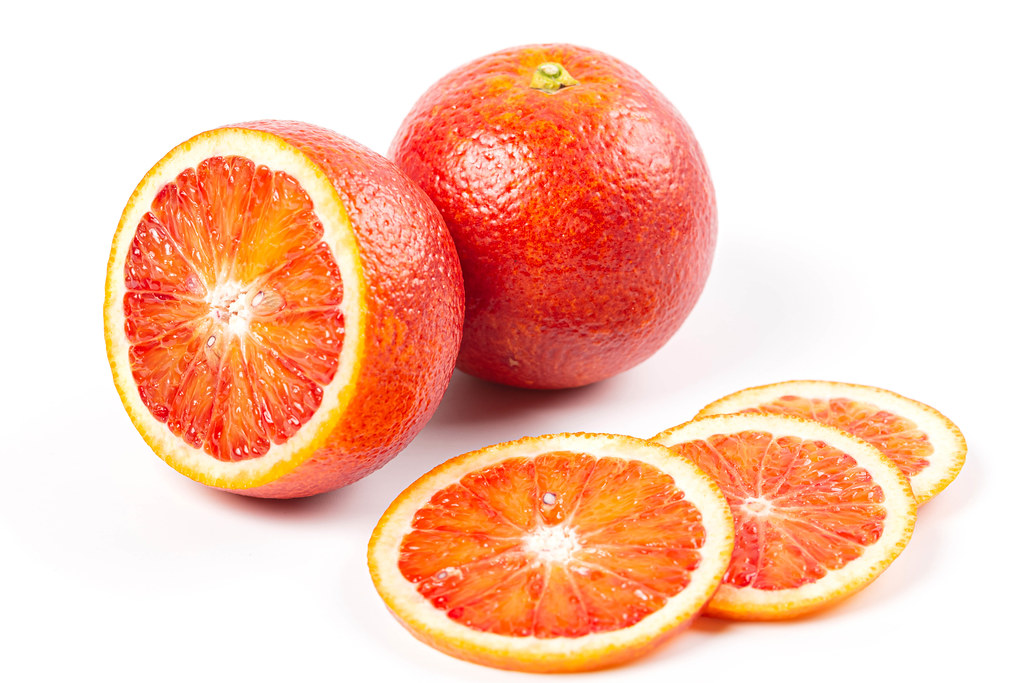Whole and sliced ripe sicilian oranges