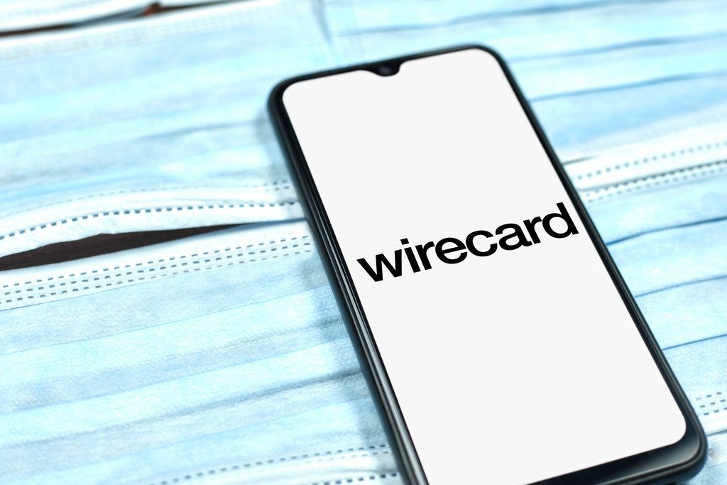 Wirecard – digital financial commerce platform for innovative digital payments. Company logo on smartphone display. Changing global business rules