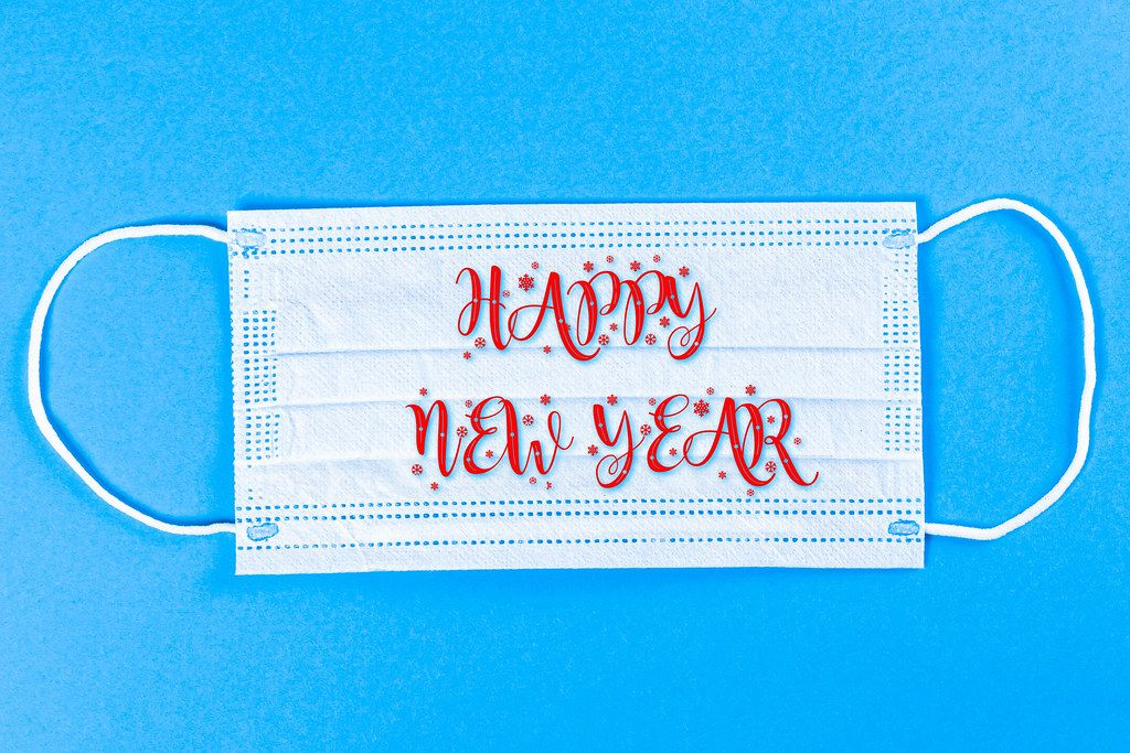 Wish a Happy New Year on a medical mask, blue background