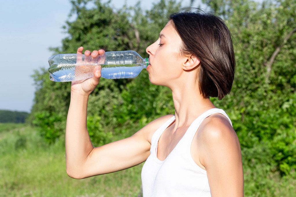 Woman drink water after sport on nature
