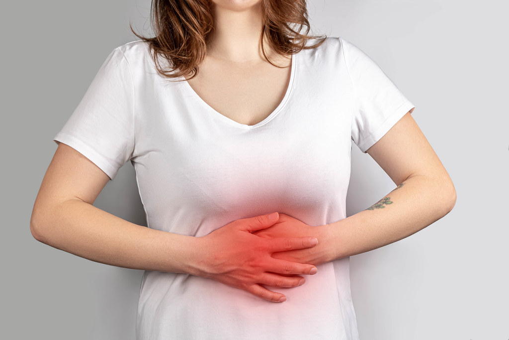 Woman experiencing abdominal pain, treatment and prevention concept