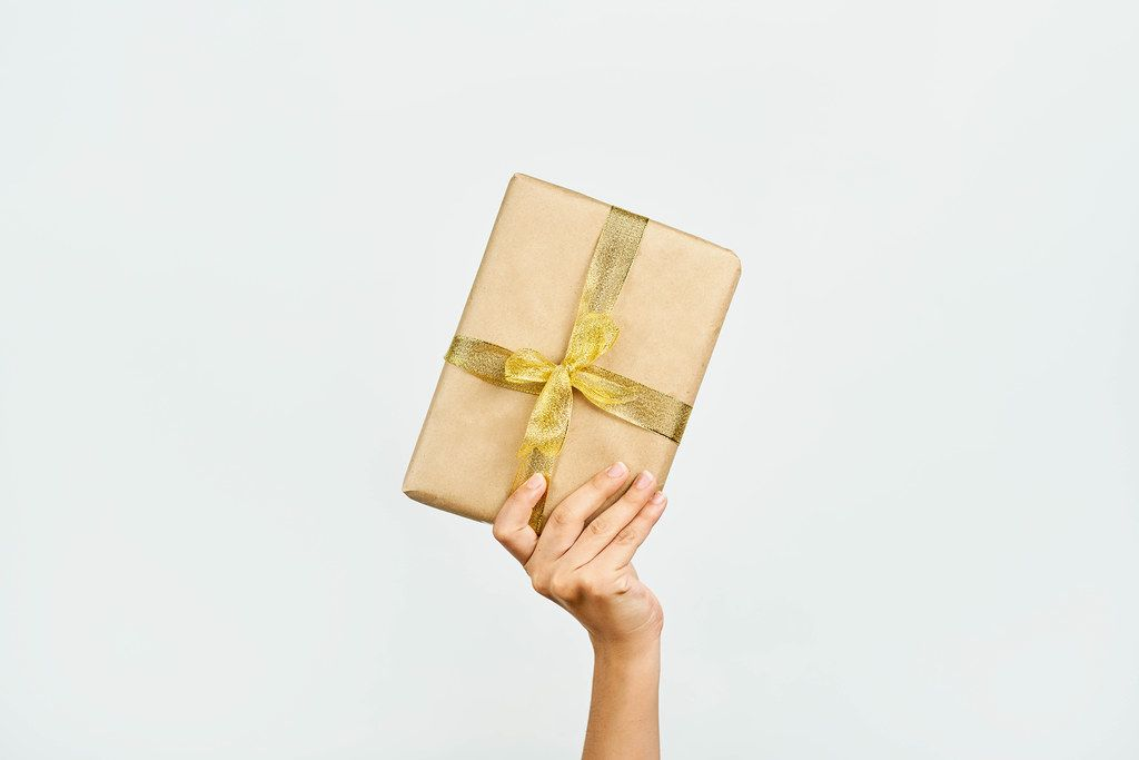 Woman hand holding a Christmas giftbox