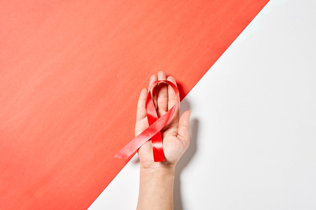 Woman holds cancer awareness ribbon