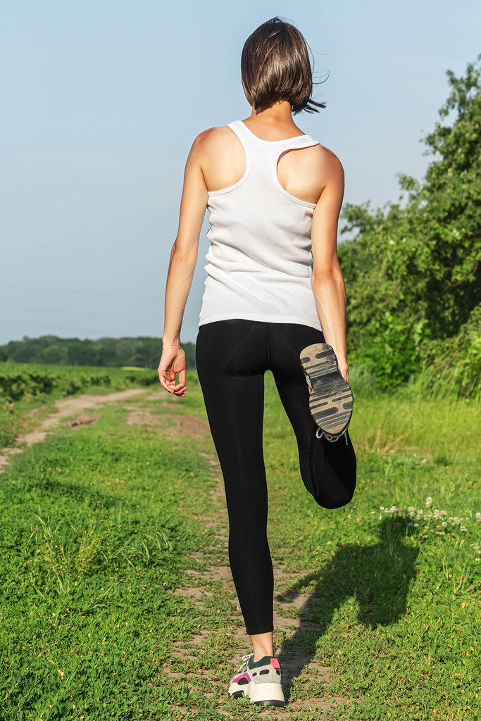 Woman is stretching before jogging. Fitness and lifestyle concept