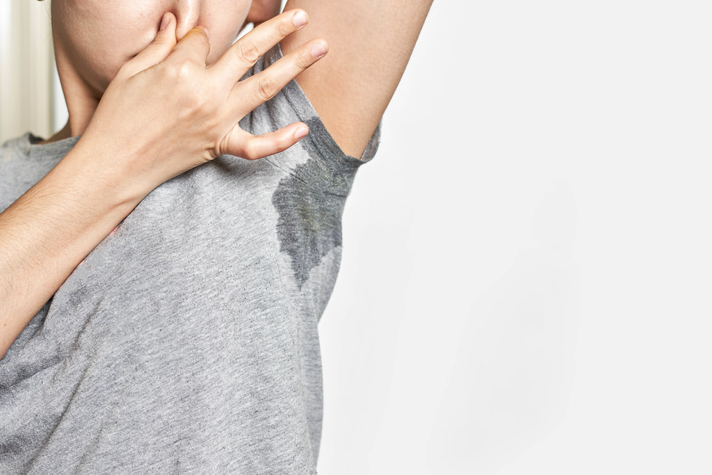 Woman sweating badly under armpit