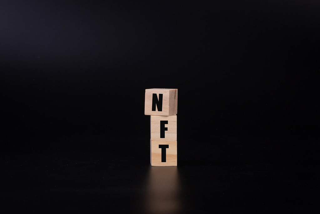 Wooden blocks with NFT text on black background
