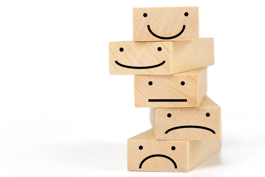Wooden blocks with symbols - smilies expressing different emotions