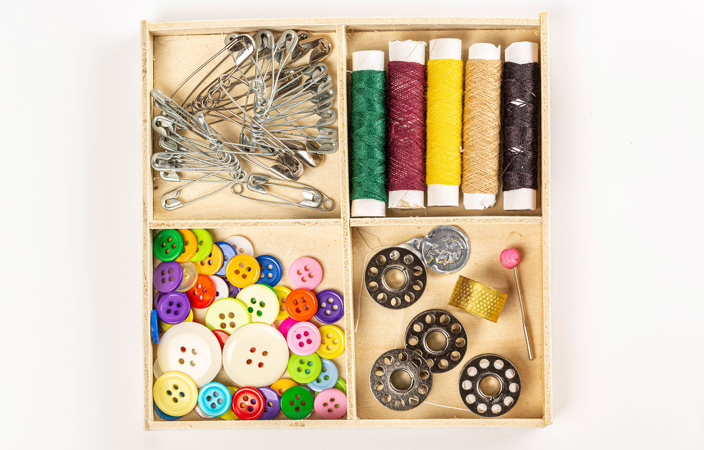 Wooden box with a set of sewing accessories, top view