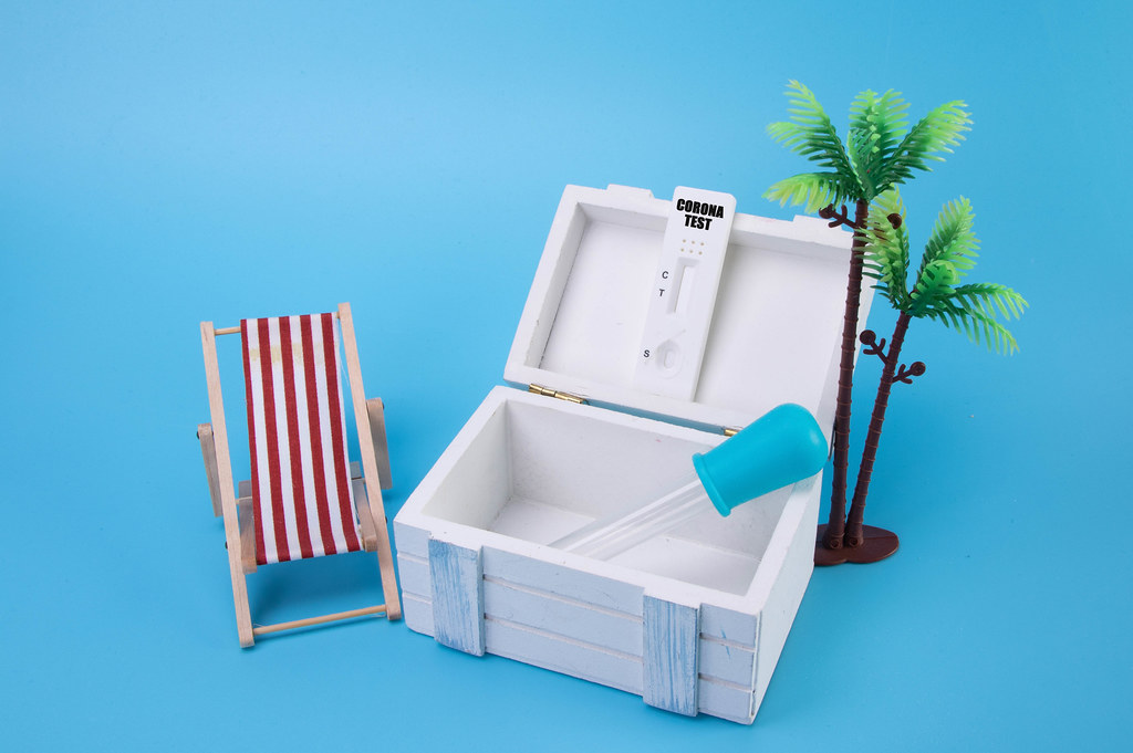 Wooden box with Coronavirus test and Vacation 2021 text