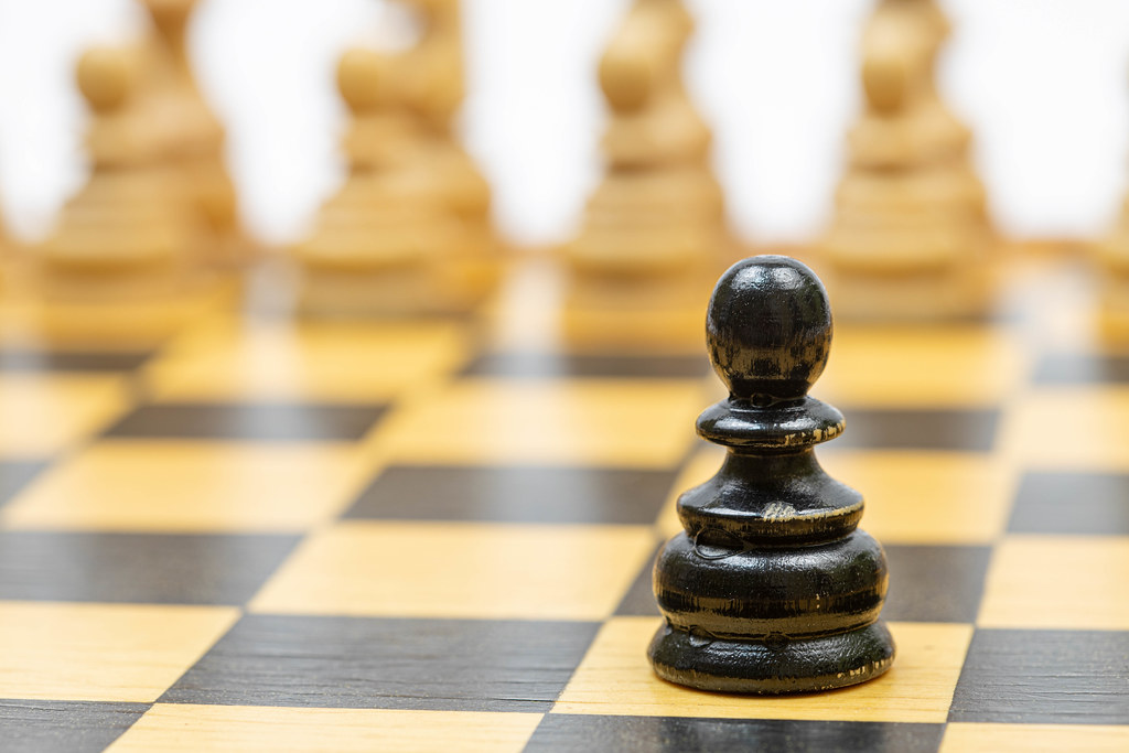 Wooden Chess figures on the chess board with strategy concept