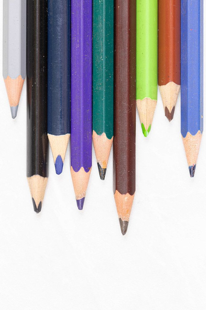 Wooden Color Pencils stacked with copy space above white background