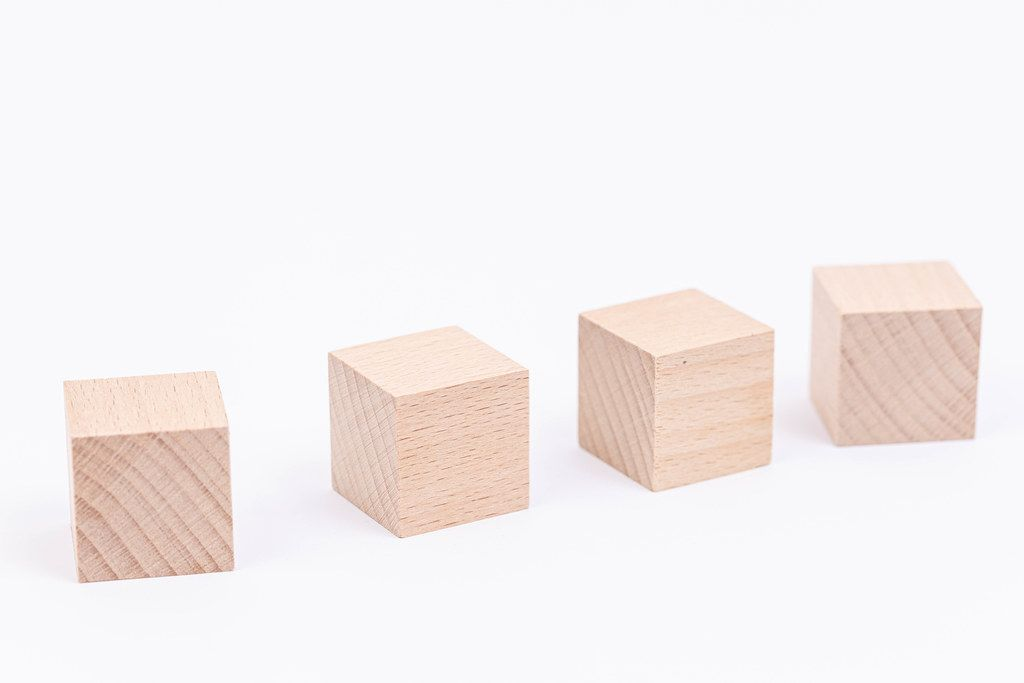 Wooden Cubes isolated above white background with copy space