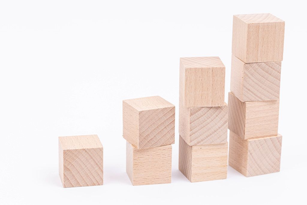 Wooden Cubes stairs with copy space above white background