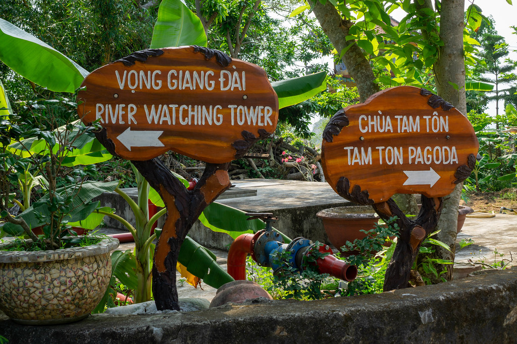 Wooden Signboards showing the Directions to the River Watching Tower and Tam Ton Pagoda at Marble Mountains in Da Nang, Vietnam