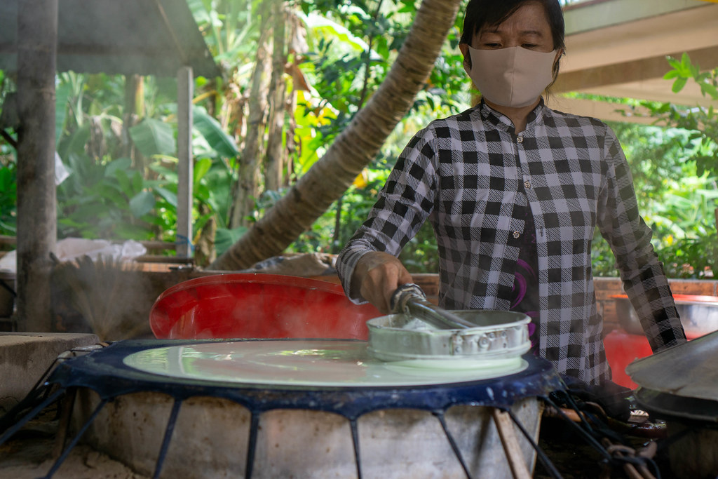 Workshop to make authentic Vietnamese Rice Paper at a local Factory in the Mekong Delta in Can Tho, Vietnam