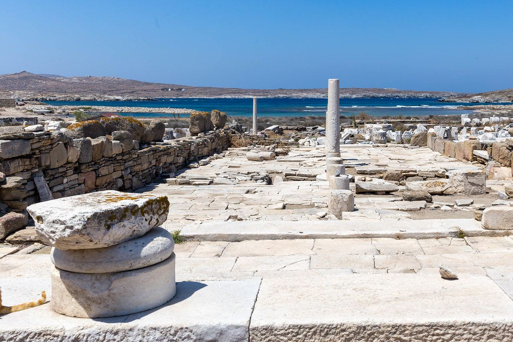 World Heritage Site: the ruins of Delos with view of the Aegean Sea and uninhabited island Rineia