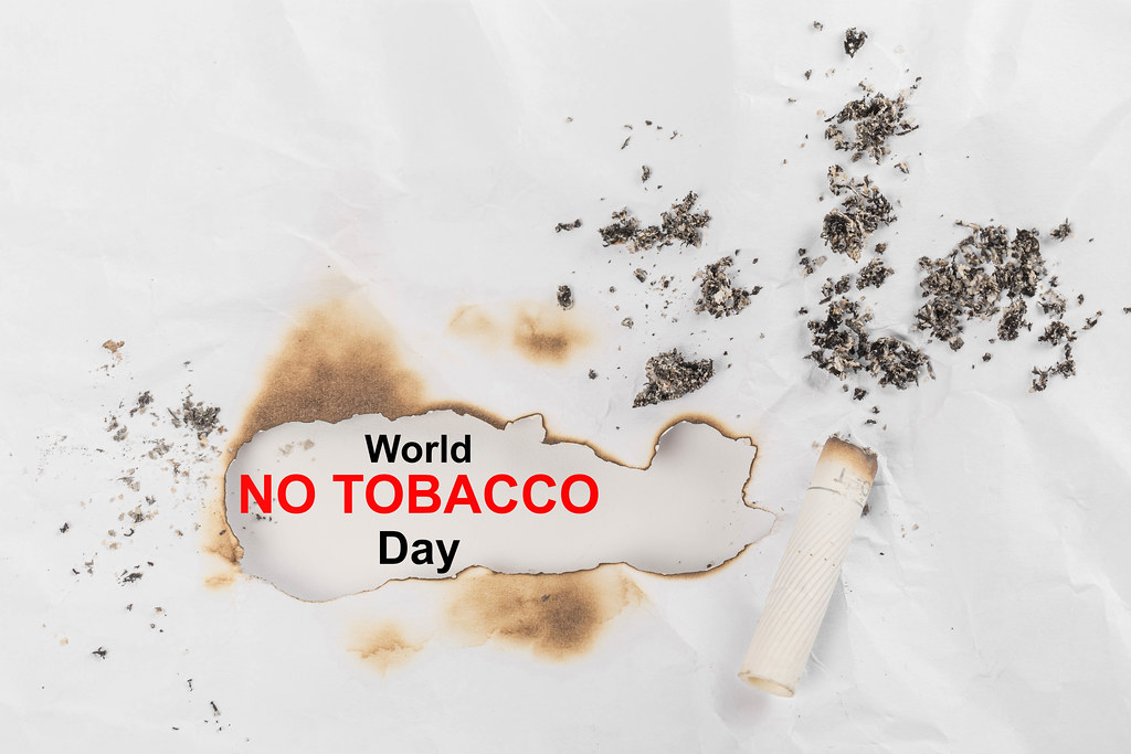 World no tobacco day background with a cigarette butt and ashes