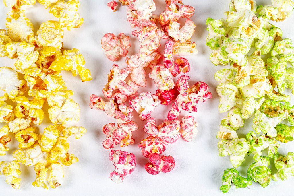 Yellow, red and green popcorn on a white background