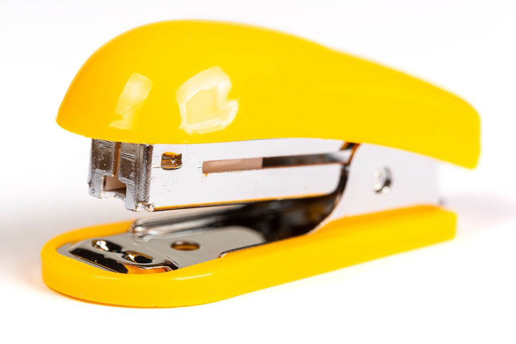 Yellow stapler on white background