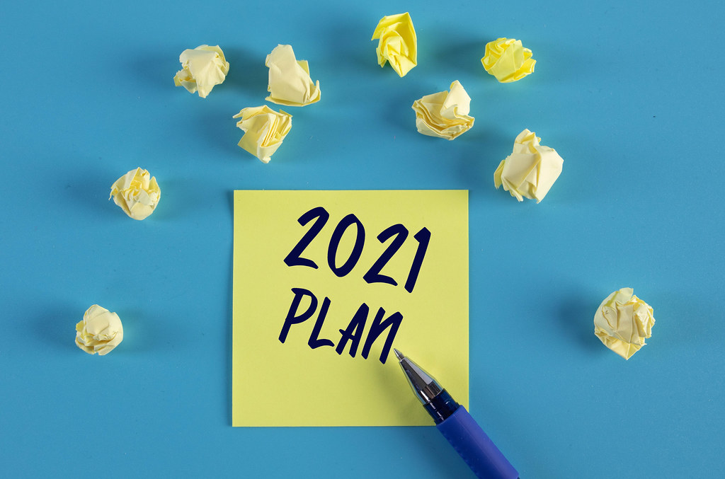 Yellow sticky note with 2021 Plan text