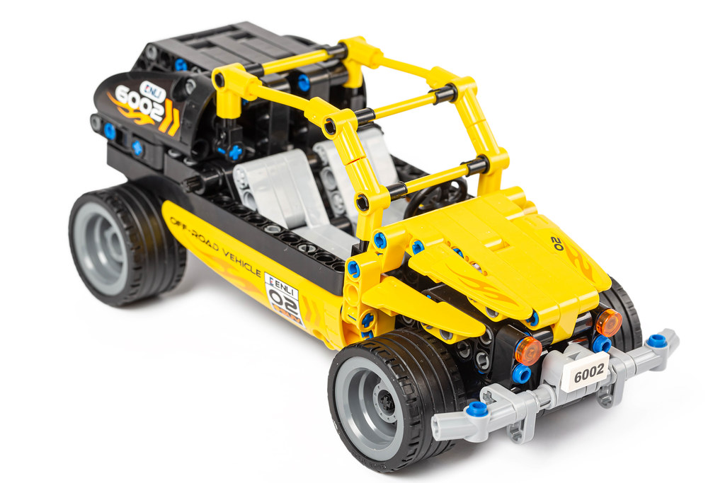 Yellow toy jeep made from a constructor