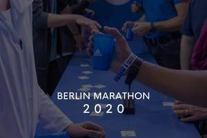 """Berlin Marathon 2020"" picture title in front of men"