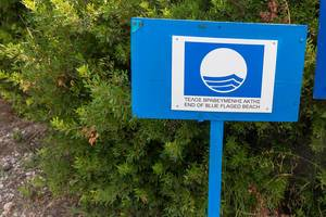 """""""End of blue flagged beach"""" is an eco-label and indicates a sustainable tourism area"""