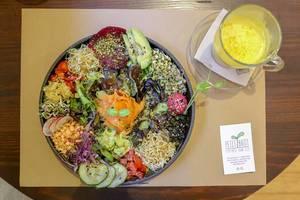 """Ensalada del Sol"" at Petit Brot Restaurant in Barcelona, Spain, with vegetables, sauerkraut sprouts, marinated mushroom & pink hummus"