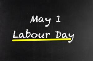 1. Mai Tag der Arbeit auf Tafel geschrieben