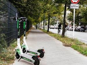 2 lime e-scooters parked on the street of Berlin.jpg