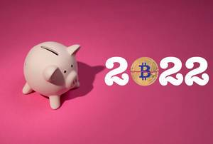 2022 text with Bitcoin and piggy bank on pink background