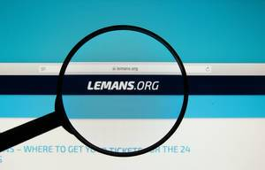 24 Hours of Le Mans official website on a computer screen with a magnifying glass.jpg