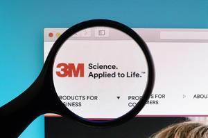 3M logo under magnifying glass